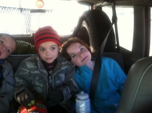 Cute kids in the back of the Jeep