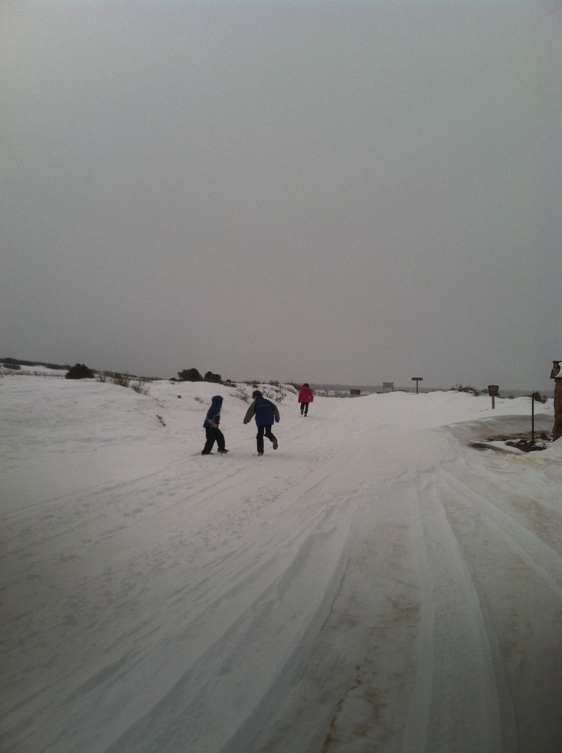 kids running in the snow