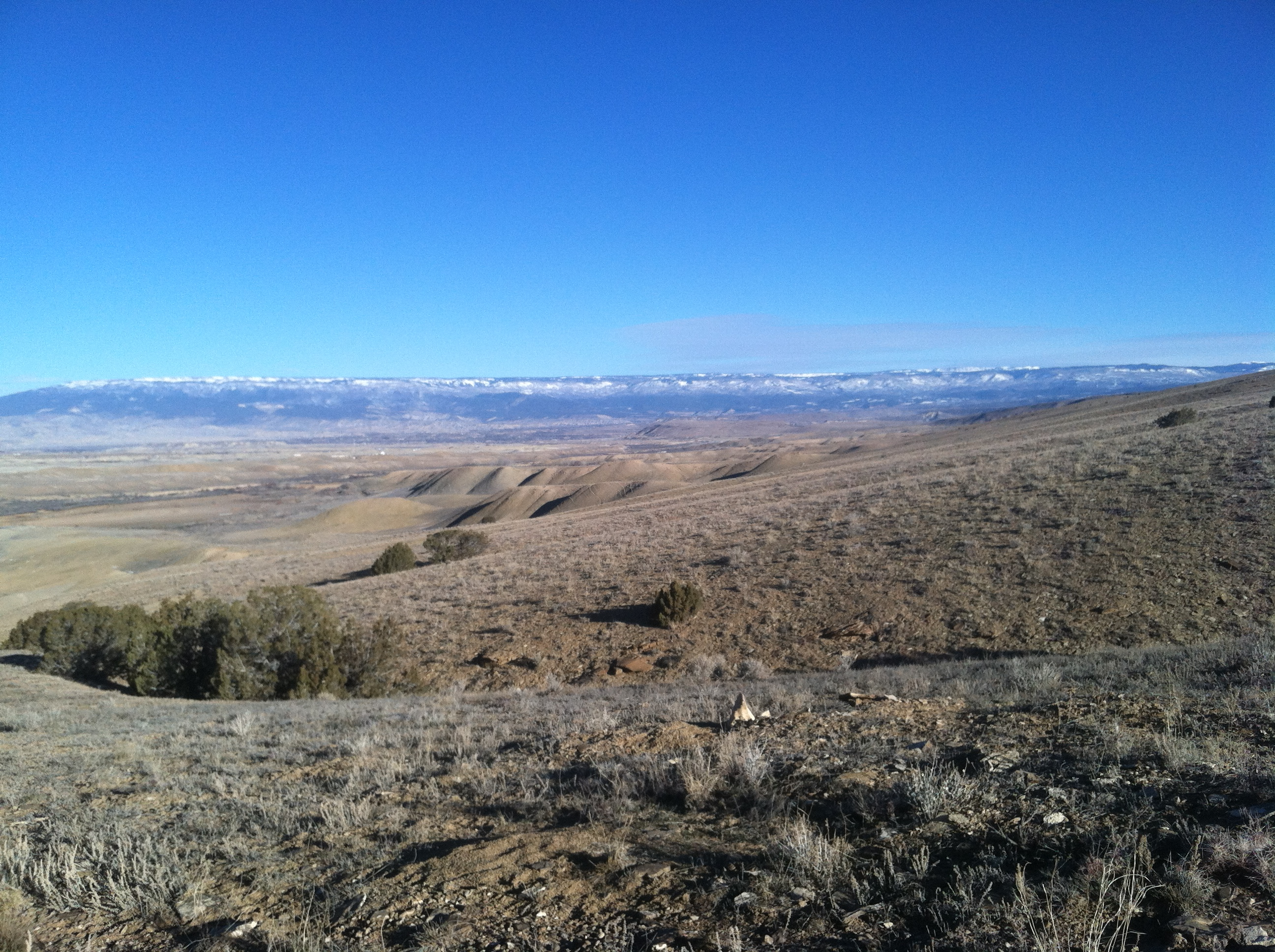 Looking north at the Grand Mesa. Yup, all of that snow tops the 10k ft tall flat mountain.