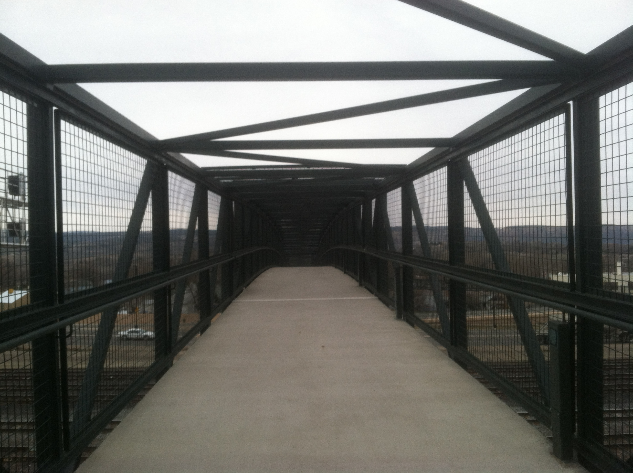 The bridge over the railroad tracks.