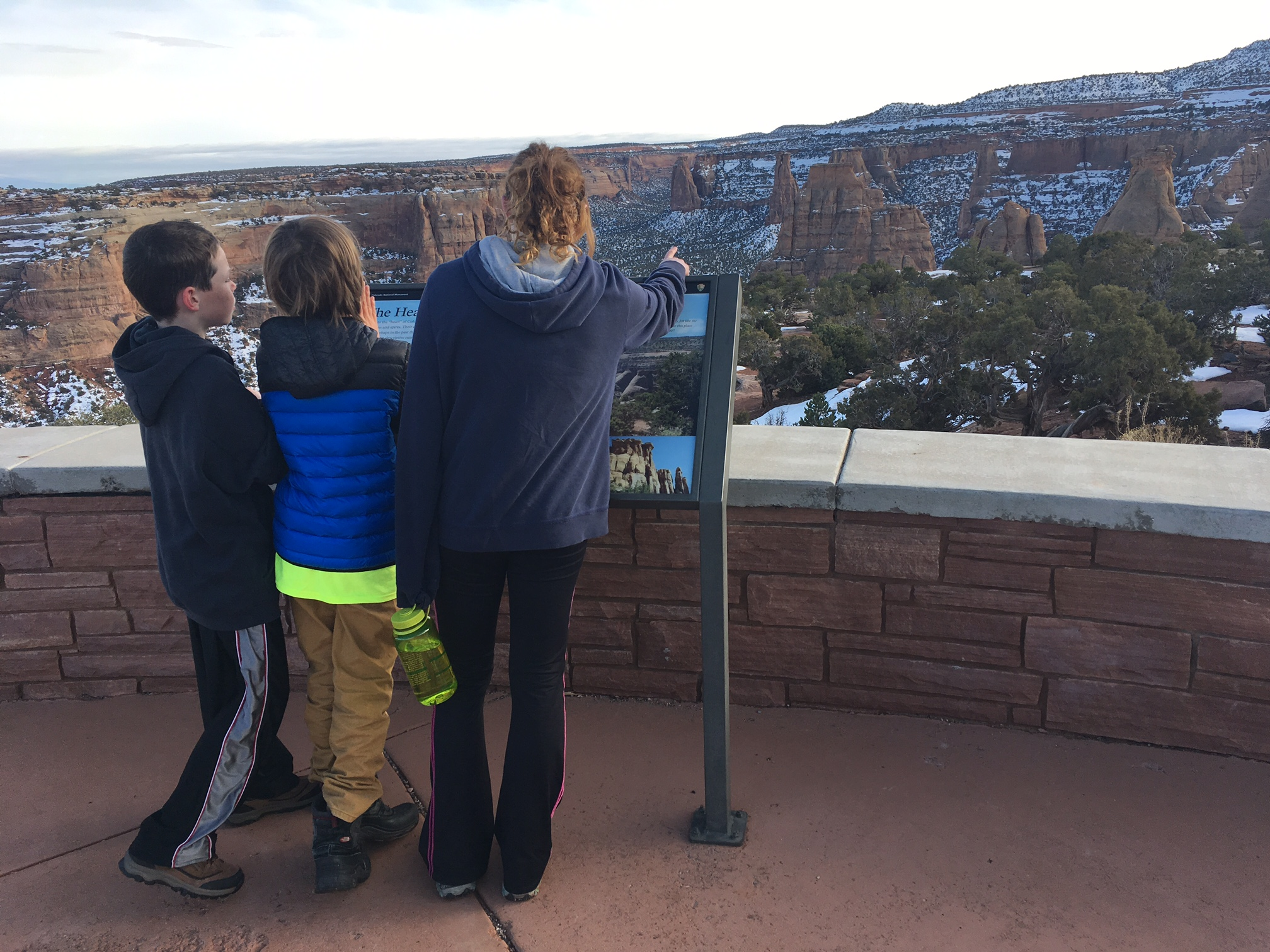 Kids reading about monument canyon in winter colorado national monument