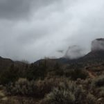 clouds hovering on the cliffs of no thoroughfare canyon