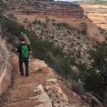hiking down into upper ute canyon colorado national monument